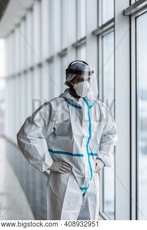 Doctor In Hazmat Suit And Goggles In Covid-19 Pandemic. Hospital Medical Staff In Protective Wear, F