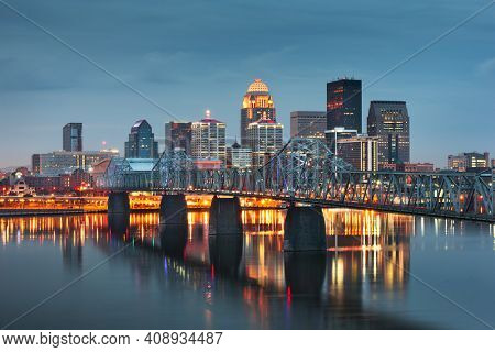 Louisville, Kentucky, USA downtown skyline on the Ohio River at dusk.