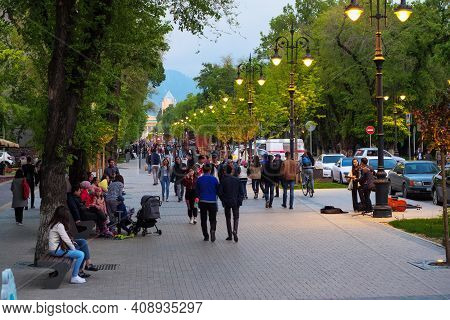 Almaty, Kazakhstan - April 29, 2019: People Walk Down The Street. City Street In The Evening. Panfil