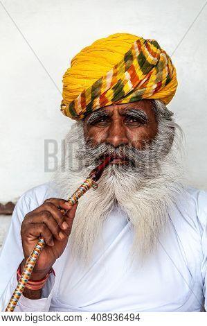 Jodhpur, India - 02 27 2012: Portrait Of Old Indian Man (rajput) Posing For Visitors Of The Mehranga