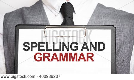 Businessman Holding Sheet Of Paper With A Message Spelling And Grammar