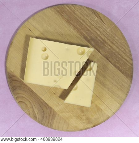 Emmental Cheese Close Up On A Cutting Round Board