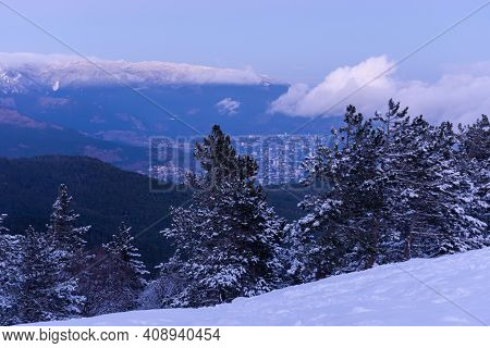 Winter Landscape At Sunset Yalta Ai-petri. Purple Colorful Sunset In Winter. Top View Of The City An