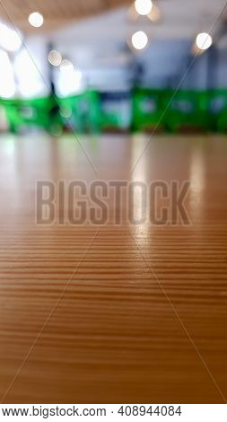 Large Cafeteria, No People Dining Room With Lots Of Wooden Tables And Green Chairs. Interior With Wo