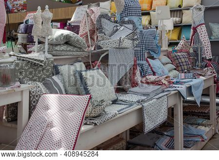 Elmshorn, Germany - May 2015. A Large Number Of Different Fabrics For Creating Home Comfort In Your