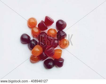 Group Of Red, Orange And Purple Multivitamin Gummies Isolated On White Background. Healthy Lifestyle