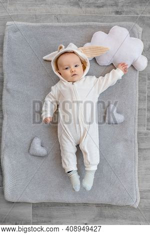 Cute kid in a rabbit costume. Easter concept