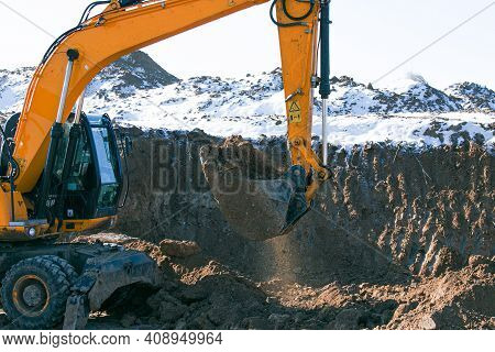 Crawler Excavator. Earth-moving Machine At A Construction Site. The Excavator In The Process Of Work