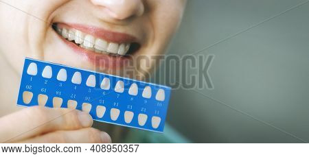 Woman Using Teeth Whitening Shade Guide. Tooth Bleaching. Banner Copy Space