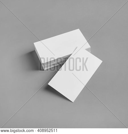 Blank White Business Cards On Gray Paper Background. Mockup For Id. Template For Graphic Designers P