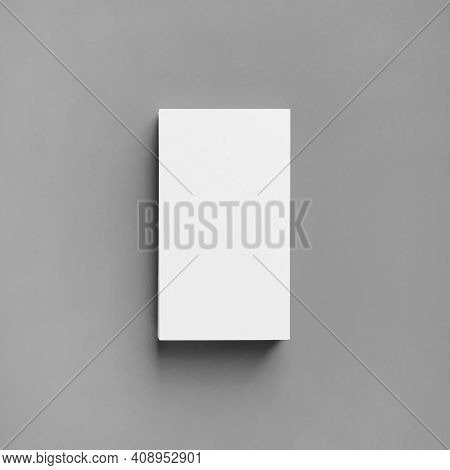 Blank White Business Card On Gray Paper Background. Mockup For Branding Identity. Top View. Flat Lay