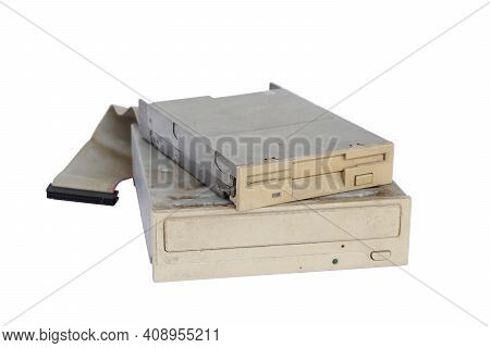 Pile Of Rusty, Old And Obsolete Computer Hardware, Like A Cd-rom, Floppy Disk, Isolated On A White B