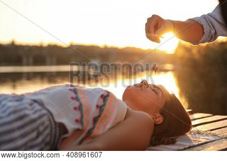 Woman At Crystal Healing Session Near River Outdoors