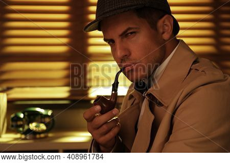 Old Fashioned Detective With Smoking Pipe In Office