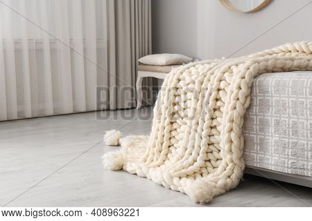 Knitted Merino Wool Plaid On Bed In Room
