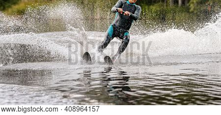 Man On Water Skiing In Summer Lake