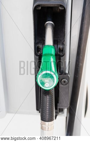 Close Up Of A Gas Pump Handle. 95 Octane Number Gas, E5 Green Handle To Fuel The Car With Gas. Europ