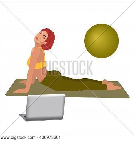 Beautiful Sporty Black Woman Practices Yoga Asana Bhujangasana - Cobra Pose In Front Of Her Laptop,