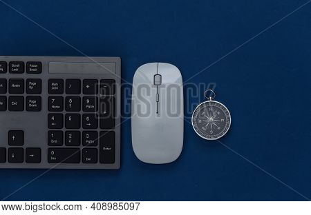 Pc Keyboard With Pc Mouse And Compass On A Classic Blue Background. Top View