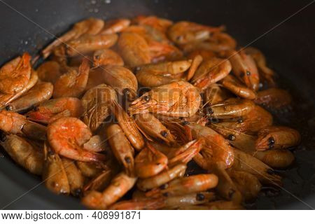 Grilled Fresh Shrimp, Fried With Spices And Butter. Close-up Of Fried Shrimp In A Frying Pan.