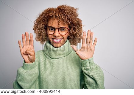 Young beautiful african american woman wearing turtleneck sweater and glasses showing and pointing up with fingers number nine while smiling confident and happy.