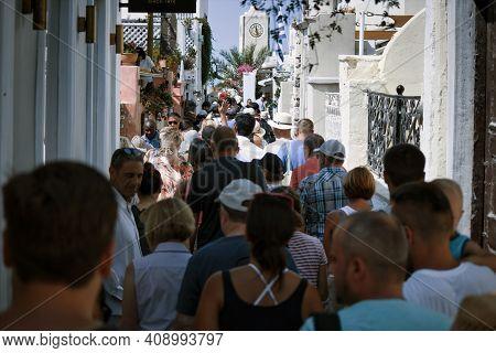 Santorini, Greece - September 11, 2017: Santorini, Greece - September 11, 2017: Tourists Crowd Rushi