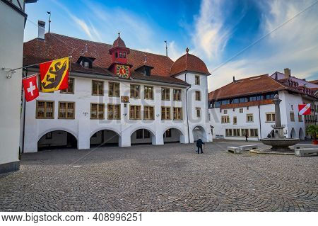 Scenic View Of Central Square, Fountain, Town Hall And Flags Of Canton Of Bern, Swiss Confederation