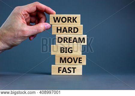 Work Hard Dream Big Symbol. Words Work Hard Dream Big Move Fast On Wooden Blocks On A Beautiful Grey