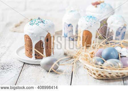 Easter Table With Easter Cakes And Easter Eggs Over White Background