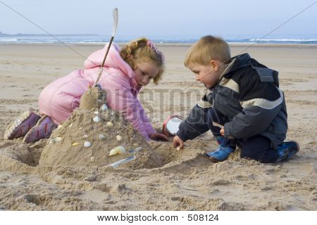 Children Building Sand Castle.