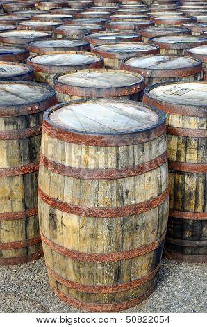 Stack Of Whisky Casks And Barrels