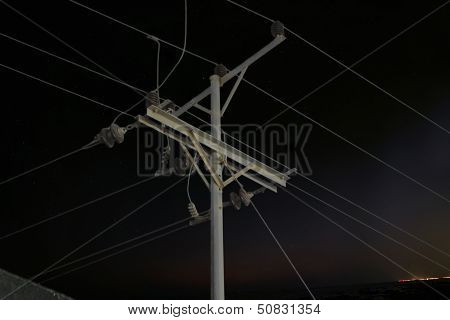 Electricity pole at night
