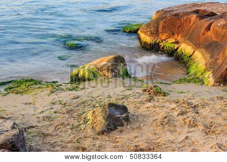 Sea Wave Strugle With Stone On The Sandy Beach