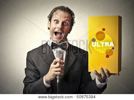 seller promotes a product speaking with the microphone