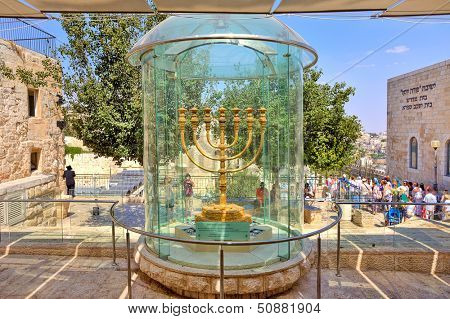 JERUSALEM - AUGUST 21: Golden Menorah two meters in height, plated with 43 kg of gold, similar to the one used in Holy Temple, now displayed in Jewish Quarter in Jerusalem, Israel on August 21, 2013.
