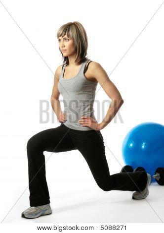 Sportswoman Lunging