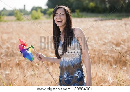 Happe young woman with windmill