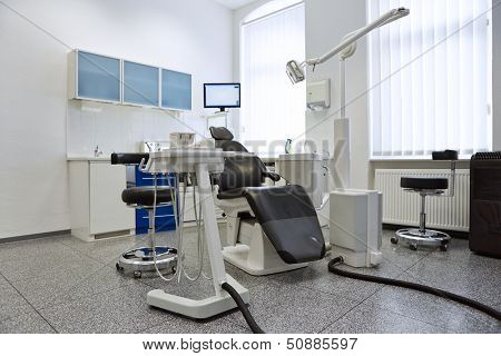 Dentist chair in bright treatment room in dental practice