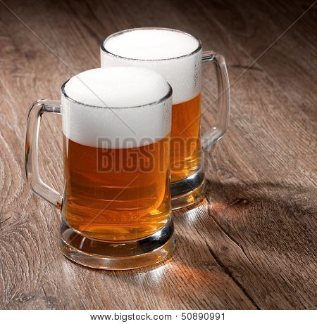 Two glass beer on wooden table