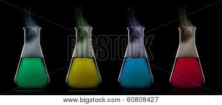 Flask With Color Liquid To The Black Background