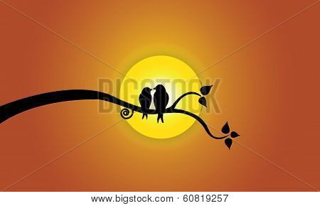 Happy Young Love Birds On Tree Branch During Sunset & Orange Sky