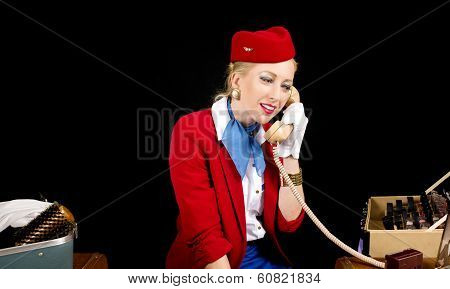 Retro Airline Stewardess Preparing For Work And Talking On The Telephone