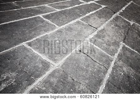 Abstract dark gray concrete pavement background texture poster