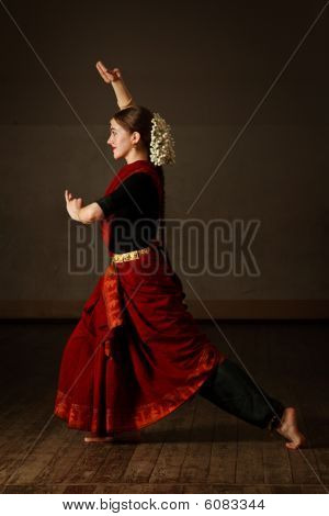 Young woman in sary dancing classical traditional indian dance Bharat Natyam poster