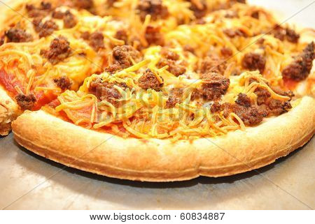 Close-up Of Taco Meat And Cheese Pizza