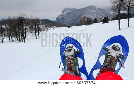Rest After A Long Walk With Snowshoes In The Mountains