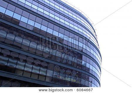Glass urban office block on white