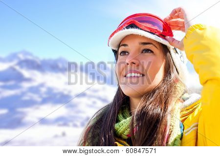 Woman In Ski Wear Contemplating View.