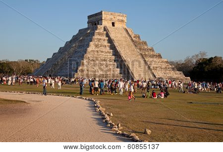 Kukulcan Temple Of Chichen Itza In The Sunset With Large Group Of People