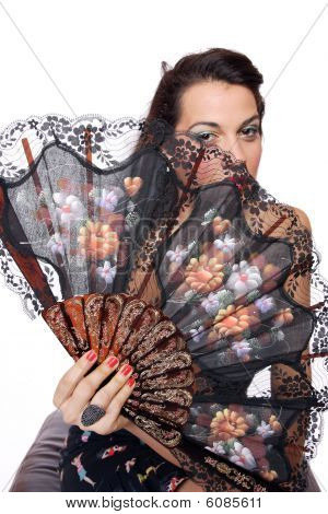 Spanish  Woman Behind Traditional Fan.